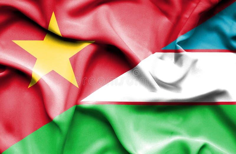 Vinkande flagga av Uzbekistan och Vietnam royaltyfri bild