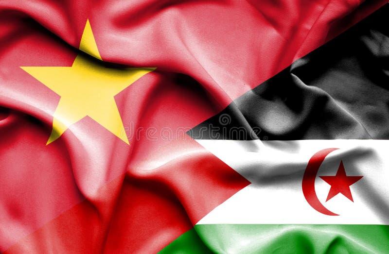 Vinkande flagga av Västsahara och Vietnam arkivfoto
