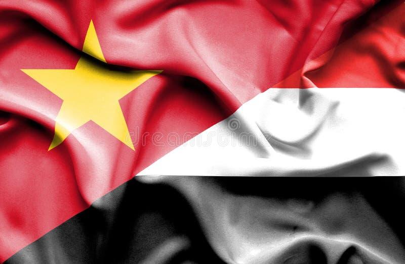 Vinkande flagga av Yemen och Vietnam royaltyfria bilder