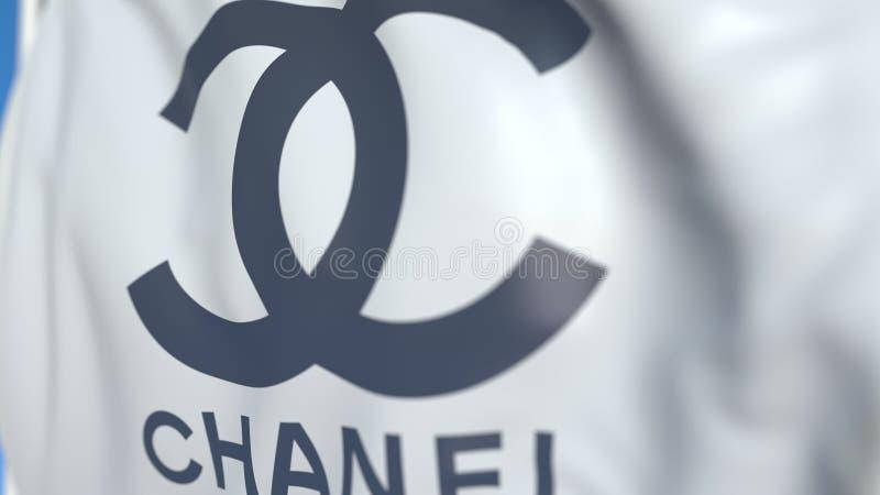 Vinkande flagga med Chanel S A logo närbild Redakt?rs- tolkning 3D royaltyfri illustrationer