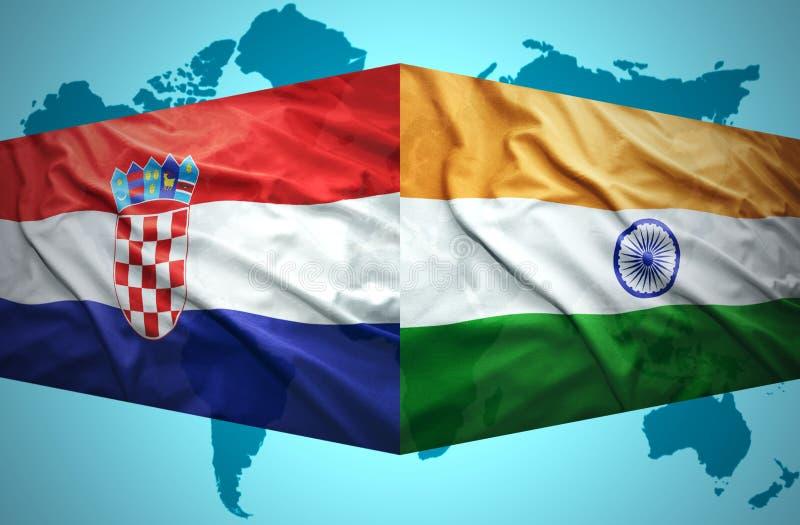 Vinkande kroat- och indierflaggor royaltyfria foton