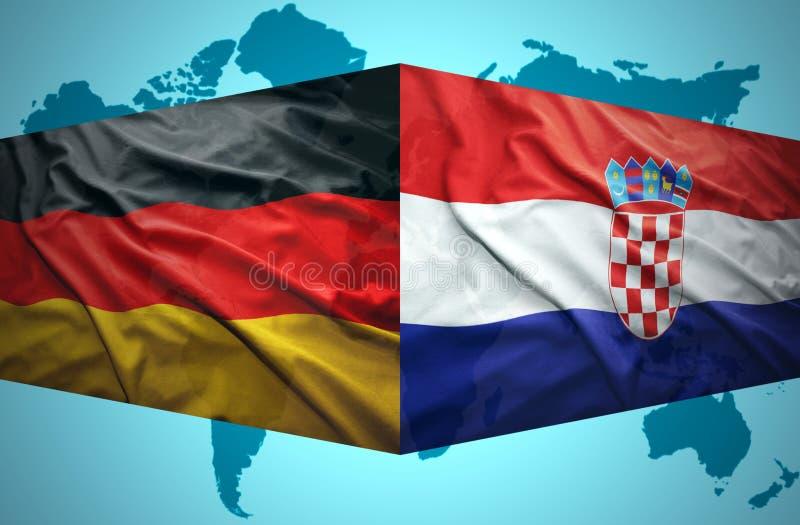 Vinkande kroat- och tyskflaggor royaltyfri bild