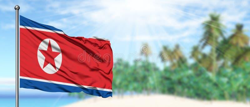 Vinkande Nordkorea flagga i den soliga blåa himlen med sommarstrandbakgrund Semestertema, feriebegrepp royaltyfria bilder