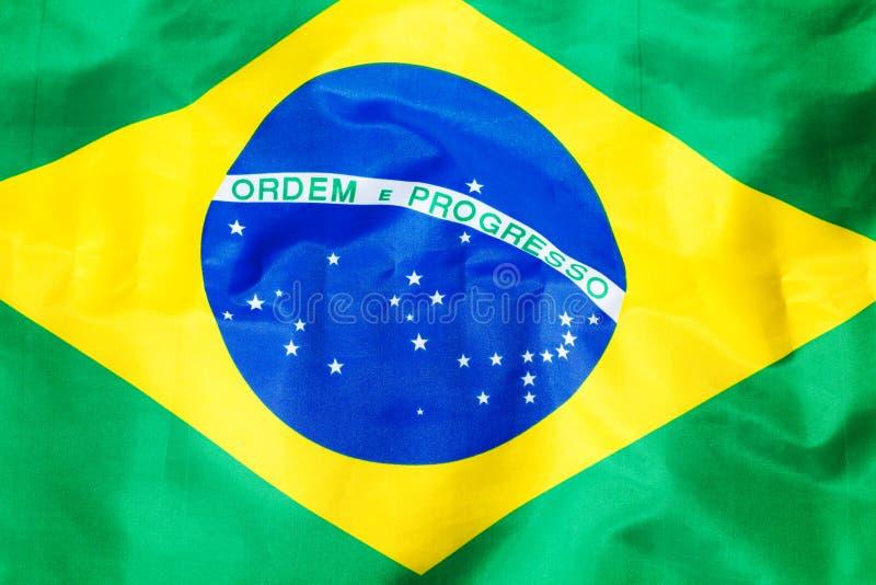Vinkande tygBrasilien flagga arkivbilder
