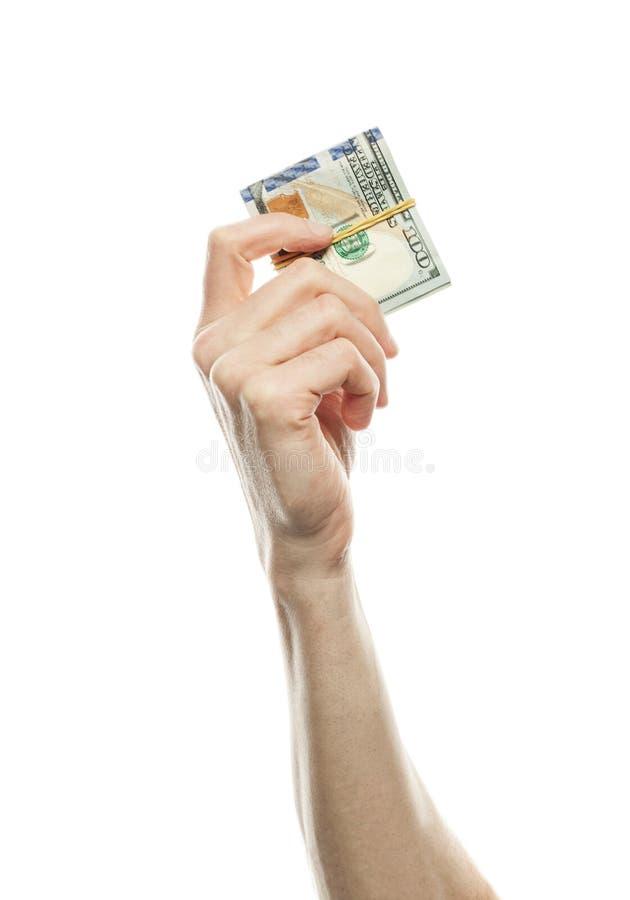 Vinnare- och seger-seger begrepp med amerikanska dollarkassapengar i handen som isoleras på vit bakgrund 100 isolerad US dollar s royaltyfri foto