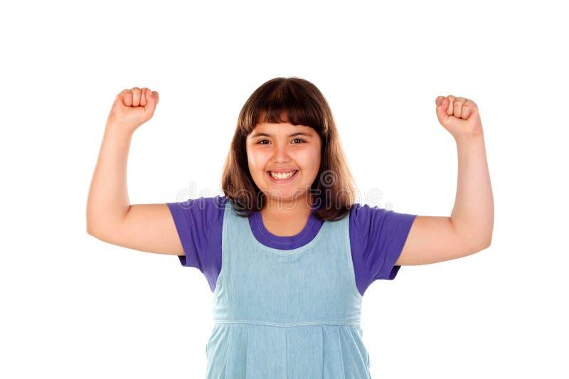 Vinnareflicka som firar något och lyfter henne armar royaltyfri foto