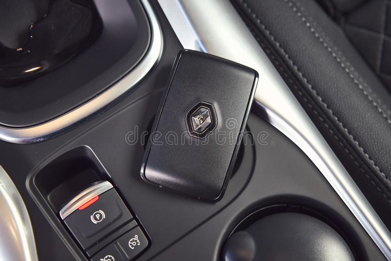 Vinnitsa, Ukraine - April 04, 2019. Renault Kadjar - new model car presentation in showroom - handbrake button and electronic key. Vinnitsa, Ukraine - April 04 stock image
