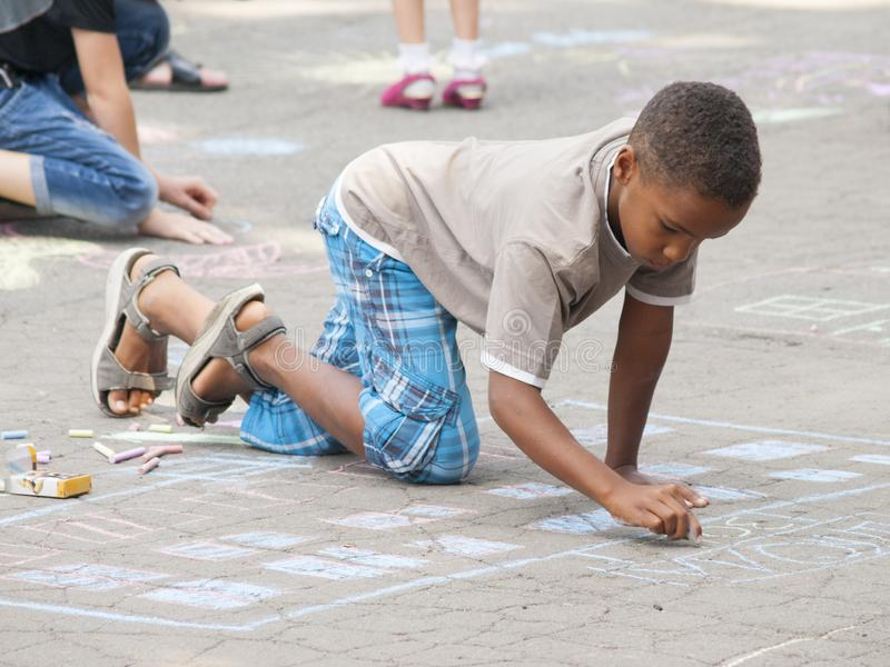 Vinnitsa, Ukraine. 08/24/2019. Children draw on the pavement with chalk. Vinnitsa, Ukraine. 08/24/2019. Boys draw drawings on the pavement with chalk stock photos