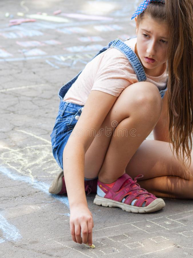 Vinnitsa, Ukraine. 08/24/2019. Children draw on the pavement with chalk. Vinnitsa, Ukraine. 08/24/2019. Girl draws with chalk on the pavement drawings stock photos