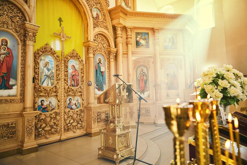 Vinnitsa,Ukraine - October 14,2018. Interior of the Orthodox church detail with candle and shrine and saint icon picture stock photography