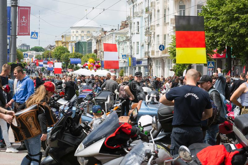 A rally of bikers for the celebration of Europe Day and people looking at what is happening royalty free stock photo