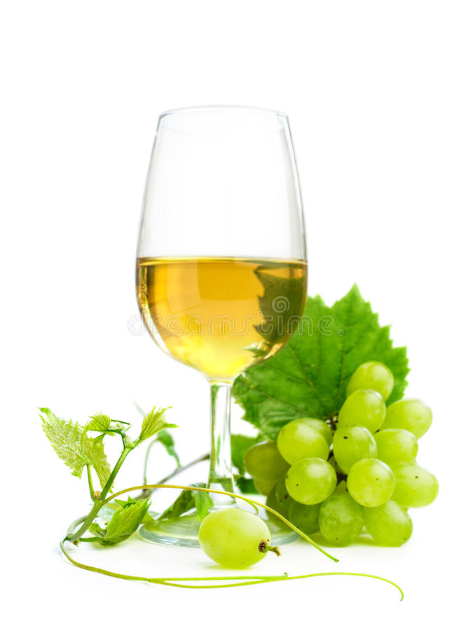 Vino blanco con las uvas foto de archivo libre de regalías