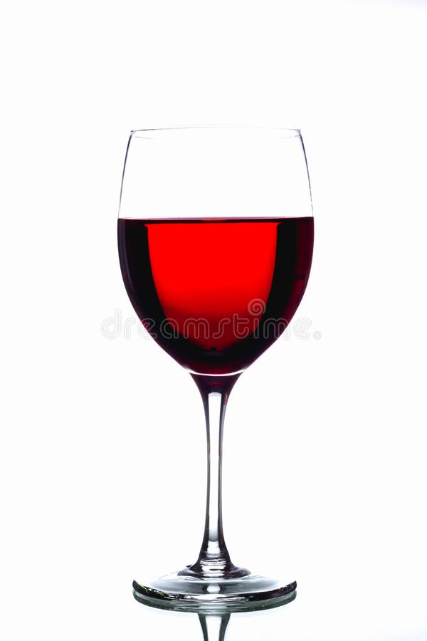 Vino rojo en un vidrio imagen de archivo libre de regalías
