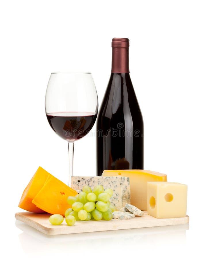 Vino rojo, queso y uvas fotografía de archivo libre de regalías