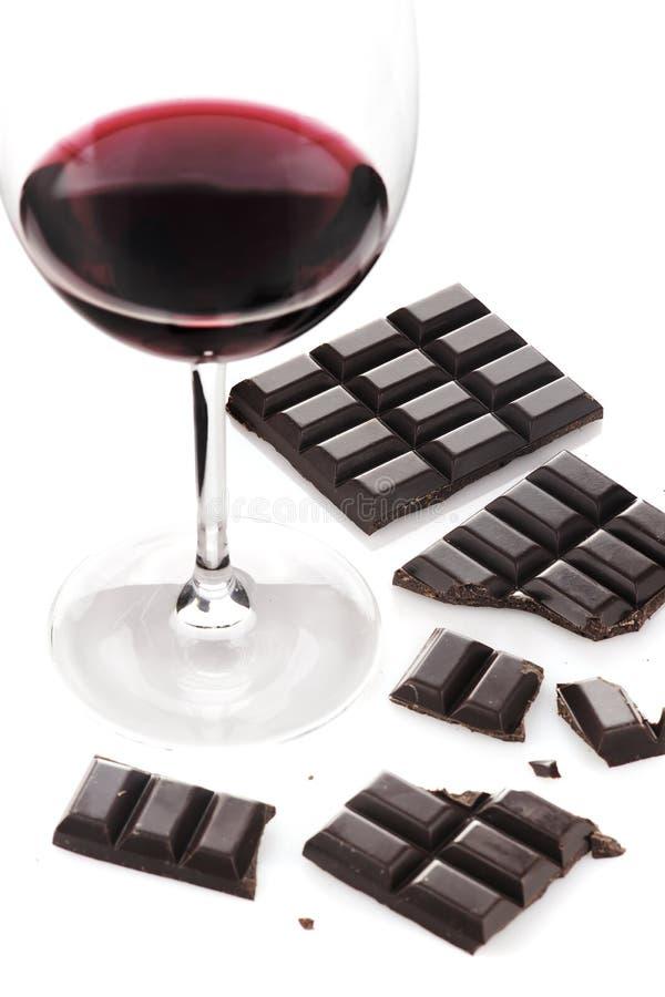 Vino rojo y chocolate imagenes de archivo