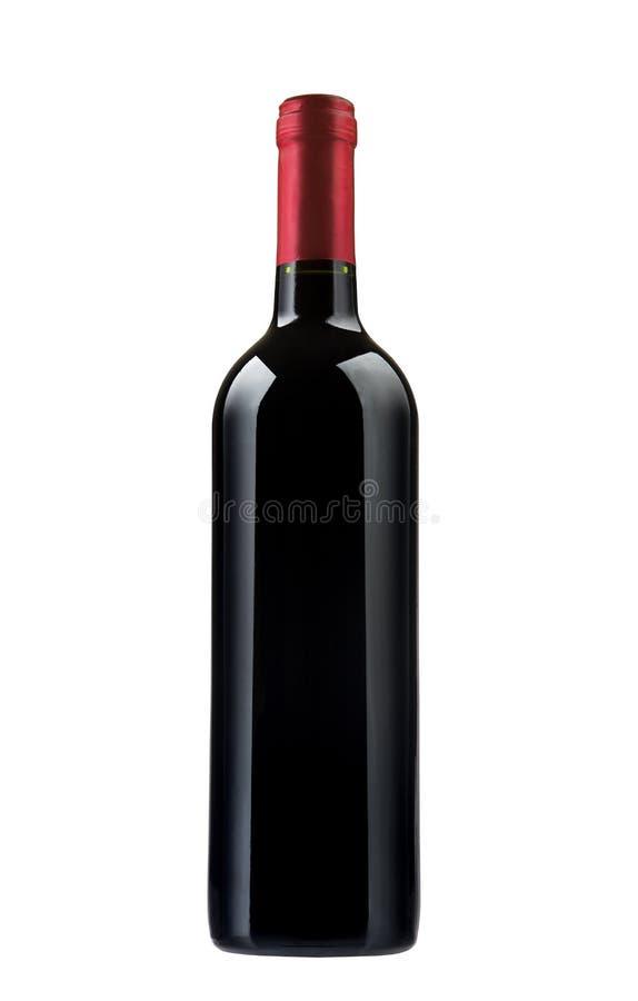 Vino rojo y una botella imagenes de archivo