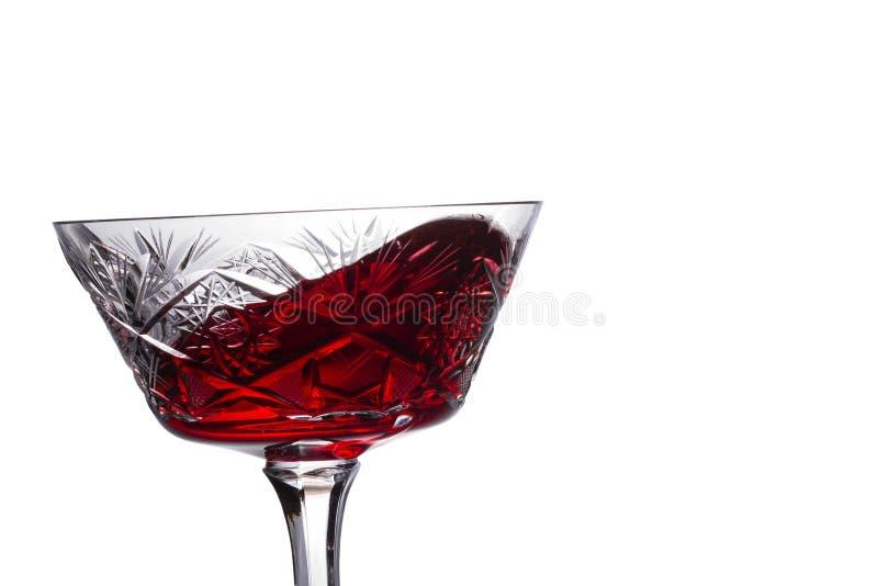 Vino rosso che spruzza in un vetro d'annata immagini stock libere da diritti