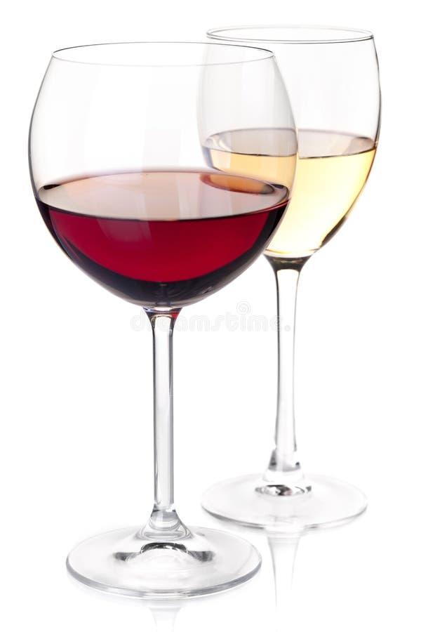 Vino rosso e bianco dell'accumulazione del vino - in vetri immagine stock libera da diritti