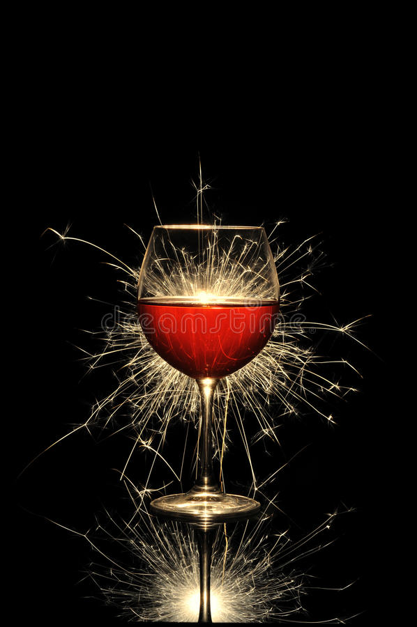 Vino rosso e fuoco d'artificio d'ardore fotografia stock