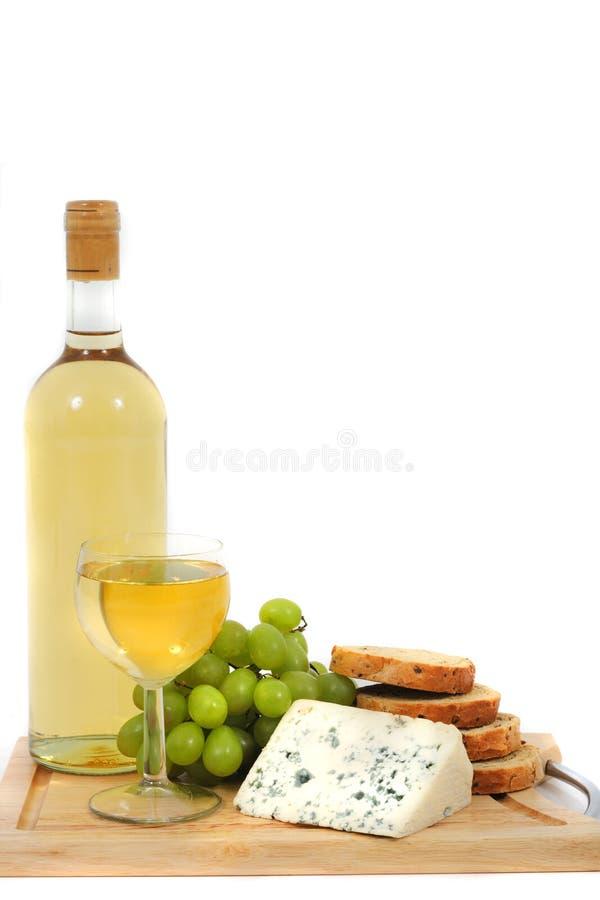 Vino, uvas, queso y pan imágenes de archivo libres de regalías