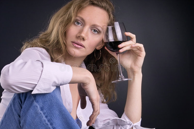 In vino veritas. Beautiful young woman with a glass of red wine in her hand