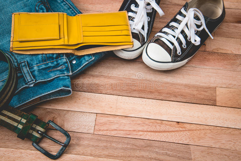 Vintag jean,cloths and accessories on a wooden background royalty free stock image