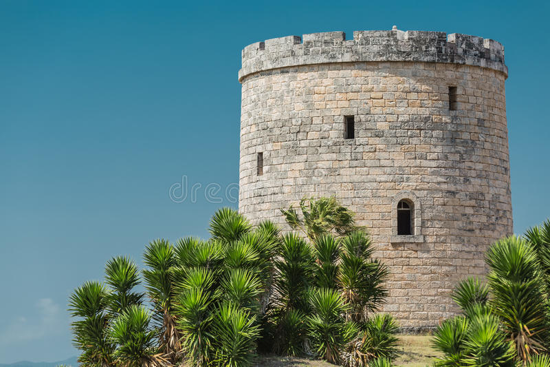 Vintage abandoned antique watch tower. Old vintage abandoned antique watch tower against clear blue sky at Varadero Cuban island stock images
