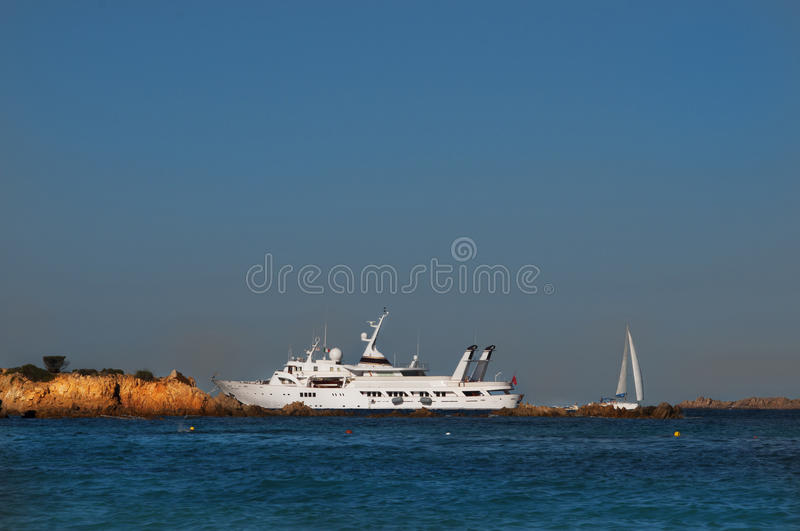 Vintage ad big yacht in sardinia royalty free stock photography