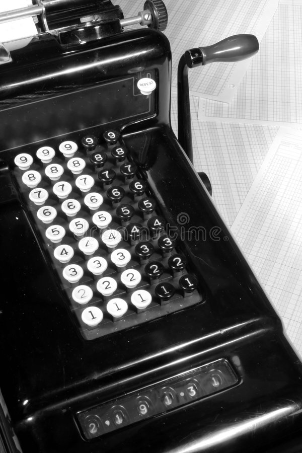 Vintage Adding Machine and Ledger Paper (Black and White). This is an image of a vintage adding machine with ledger paper and ledger paper stock images