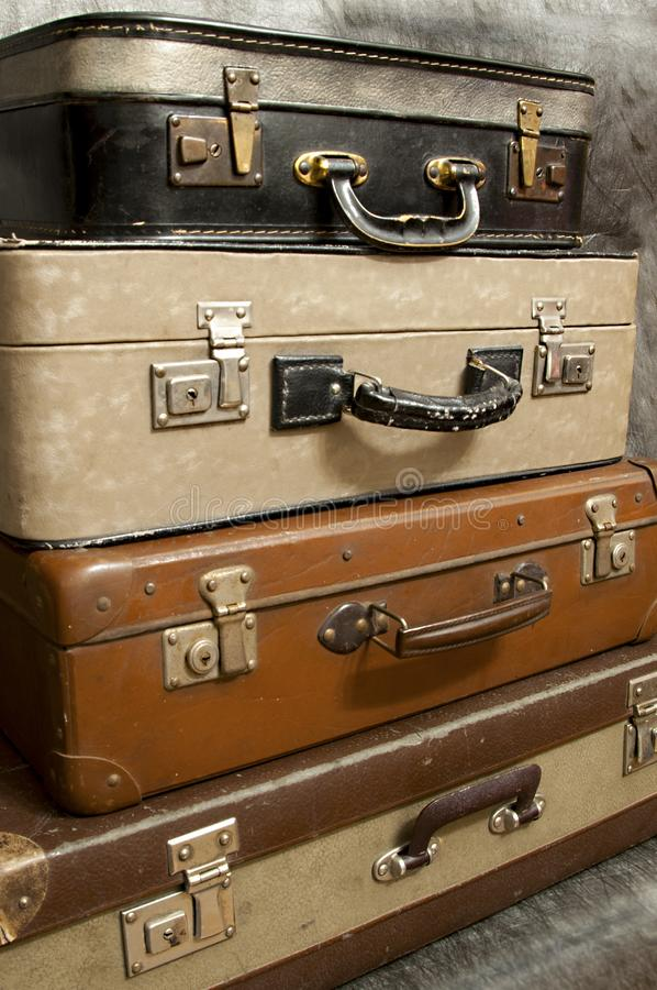 Vintage, aged suitcases on stack stock photos