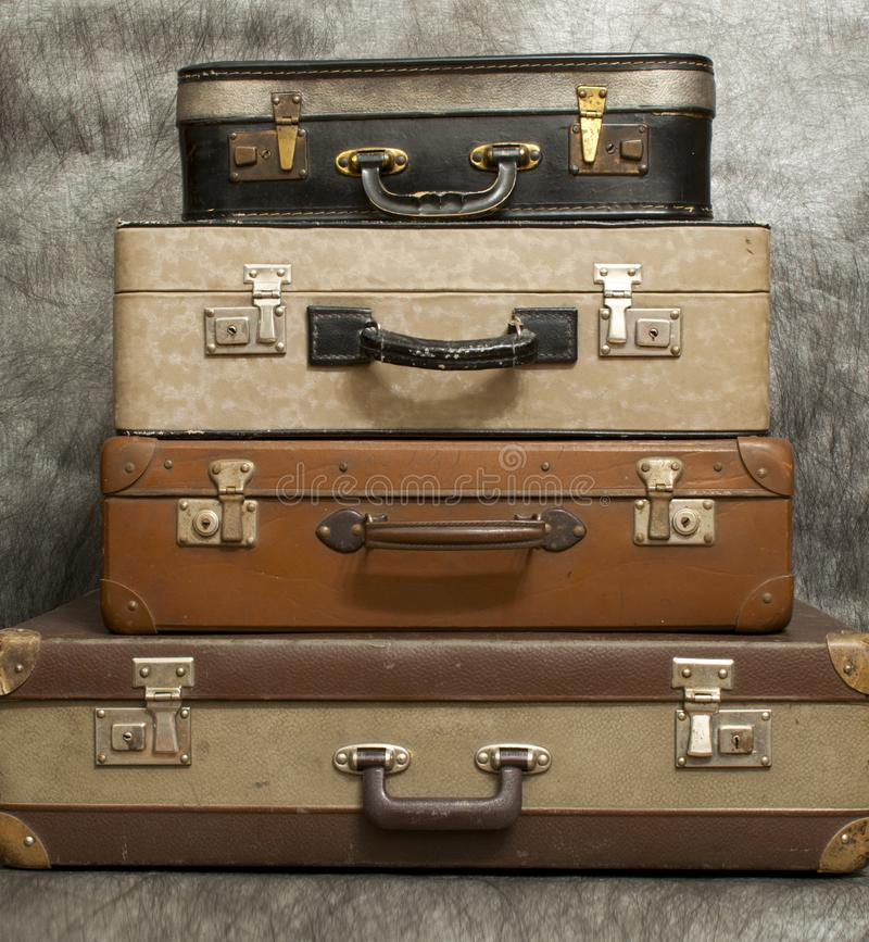 Vintage, aged suitcases on stack stock photo