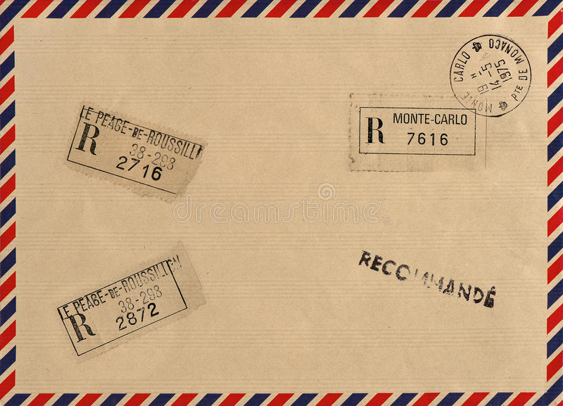 Vintage airmail envelope with stamps. Grungy background royalty free stock images