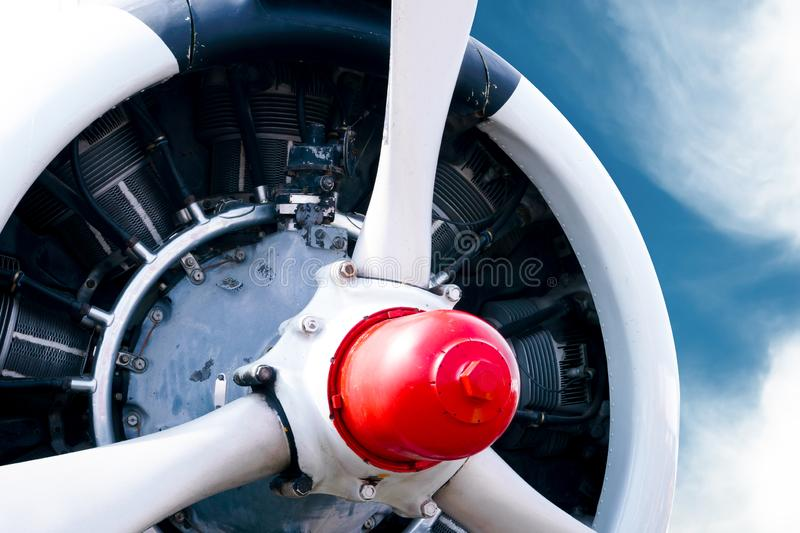 Vintage airplane propeller with radial engine on a beautiful blue sky. Vintage airplane propeller with radial engine on beautiful blue sky royalty free stock images