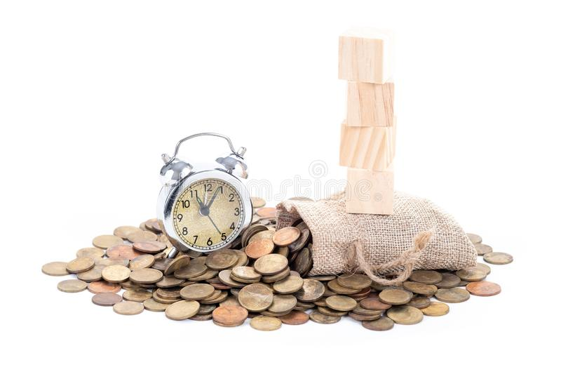 Vintage alarm clock bell, empty wooden blocks on Money bags and coins on white background.Time to invest, time value for money,. Money saving, finance saving stock photos