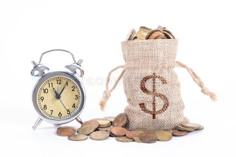 Vintage alarm clock bell with money bags and coins on white background.Time to invest, time value for money, family planning,. Money saving, finance saving and royalty free stock image