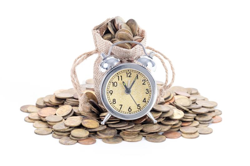 Vintage alarm clock bell with money bags and coins on white background.Time to invest, time value for money, family planning,. Money saving, finance saving and royalty free stock photos