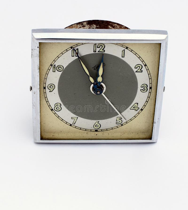 Vintage alarm clock. Countdown five minutes to twelve. High time to do something stock photo