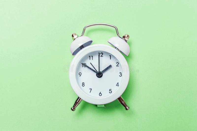 Vintage alarm clock Isolated on green pastel background stock photo