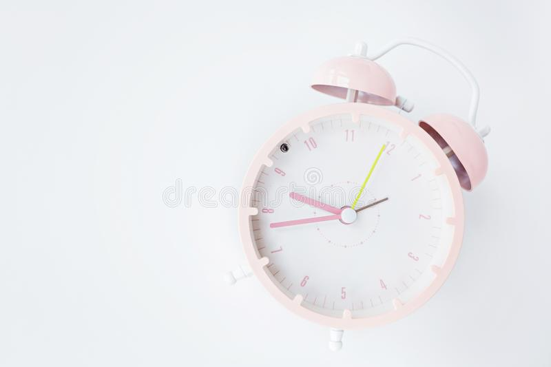 Vintage alarm clock pink color on white background. Rest hours time of life good. Flat lay, top view, copy space, mockup, overhead stock image