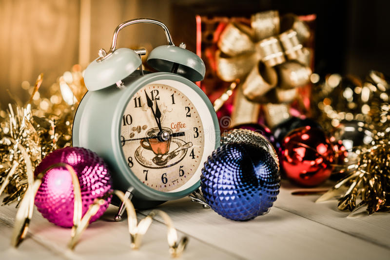 Vintage alarm clock showing five minutes to midnight stock images