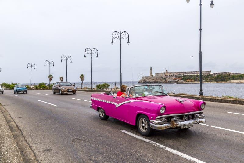Vintage American car, Havana, Cuba. Vintage American car driving along the Malecon, Havana, Cuba stock photography
