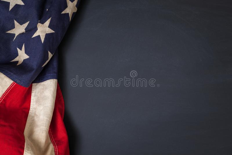 Vintage American Flag Bordering Blank Chalkboard. Vintage American flag bordering a blank chalkboard with space for text stock images
