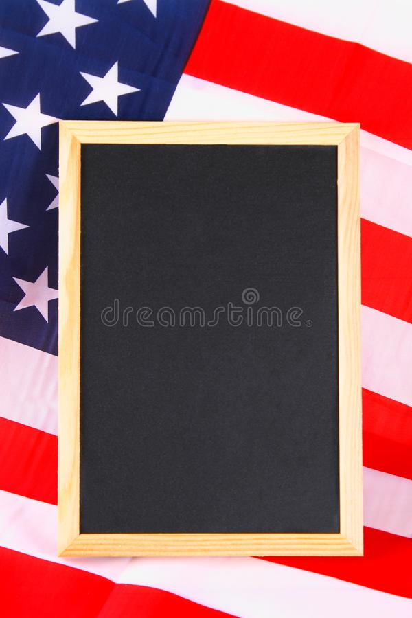 Vintage American flag on a chalkboard with space for text. royalty free stock photos