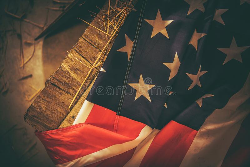 Vintage American Flag. Laying on the Aged Wooden Crate. Closeup Photo. United States of America National Flag royalty free stock photos