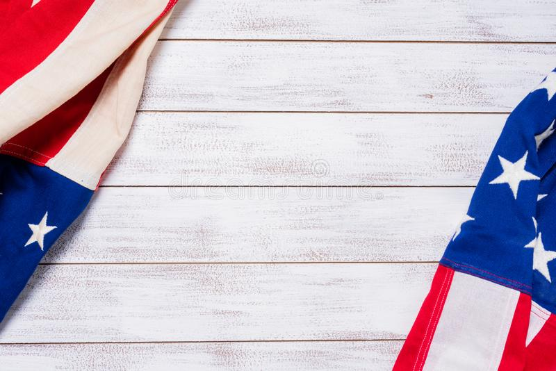 Vintage American flags on a white wooden slat background. A set of American flags on a white slat wood background with copy space stock photography