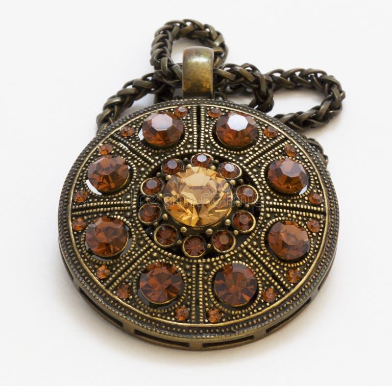 Vintage amulet. On a white background royalty free stock image