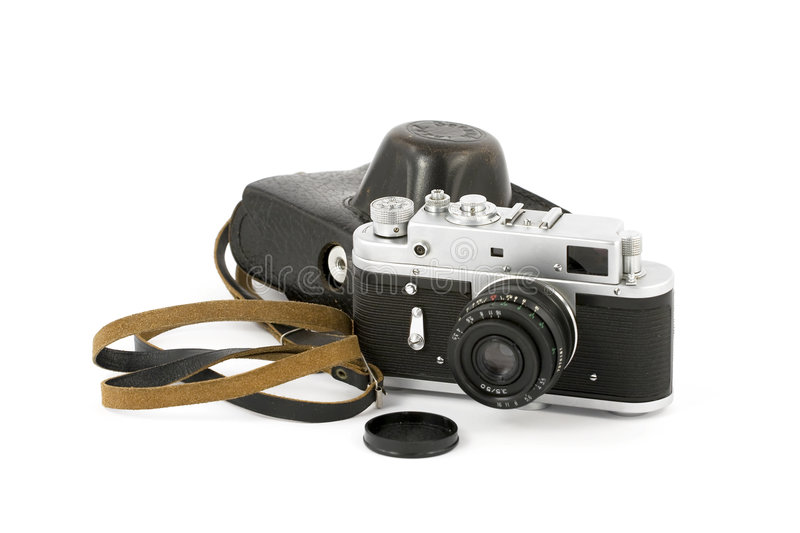 Vintage Analog Camera. With a leather carry-case over pure white background royalty free stock photo