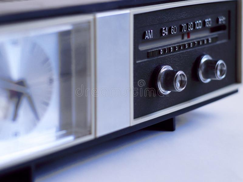 Vintage analog clock radio with radio dial in focus stock images