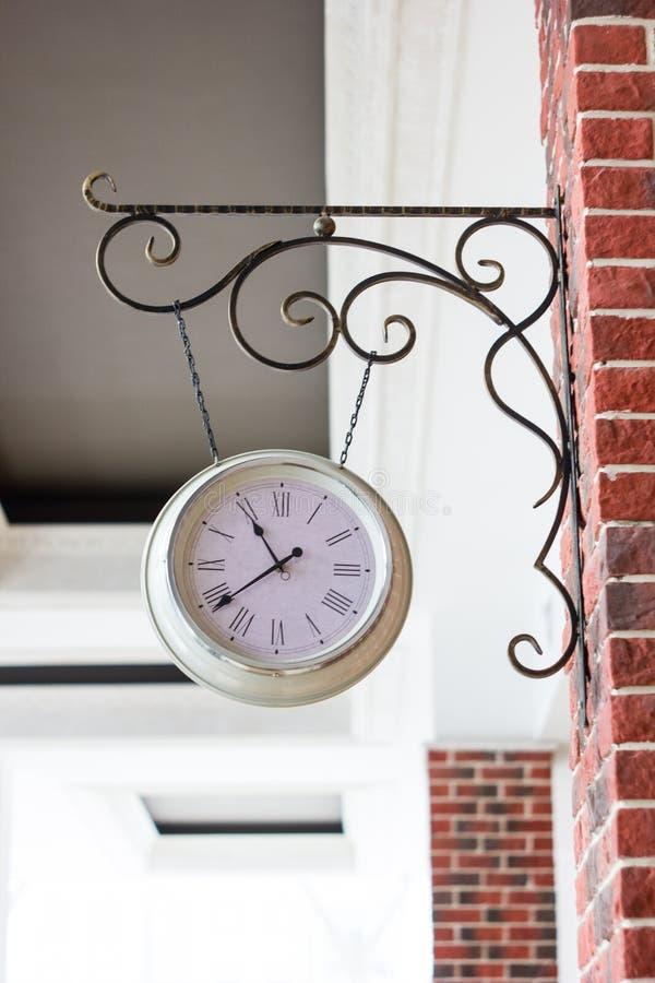 Vintage analog clock on street of Russia. Vintage analog clock on street of Russia stock image