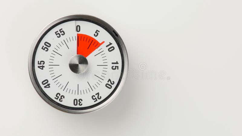 Vintage analog kitchen countdown timer, 8 minutes remaining royalty free stock photo